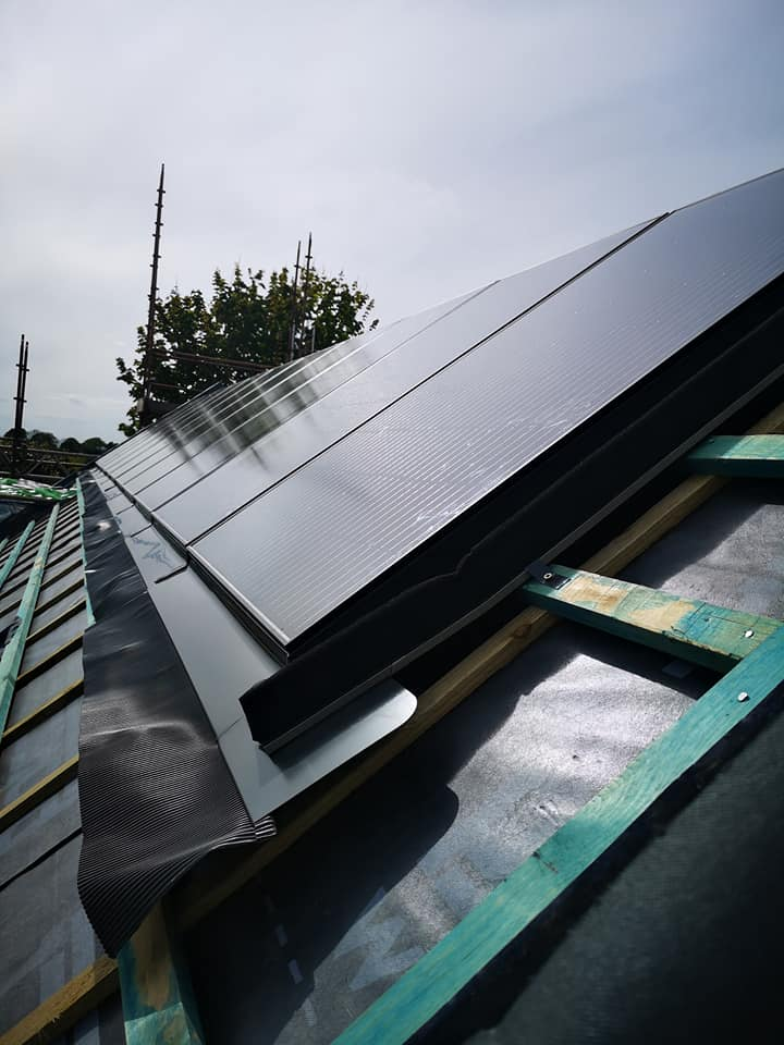 Unfinished solar panels on a roof