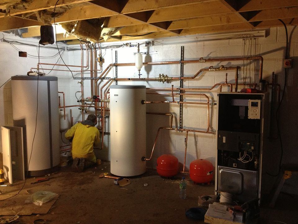 Underfloor heating being installed by Greystone